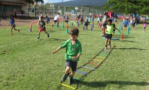 Young children playing outside during physical education class time