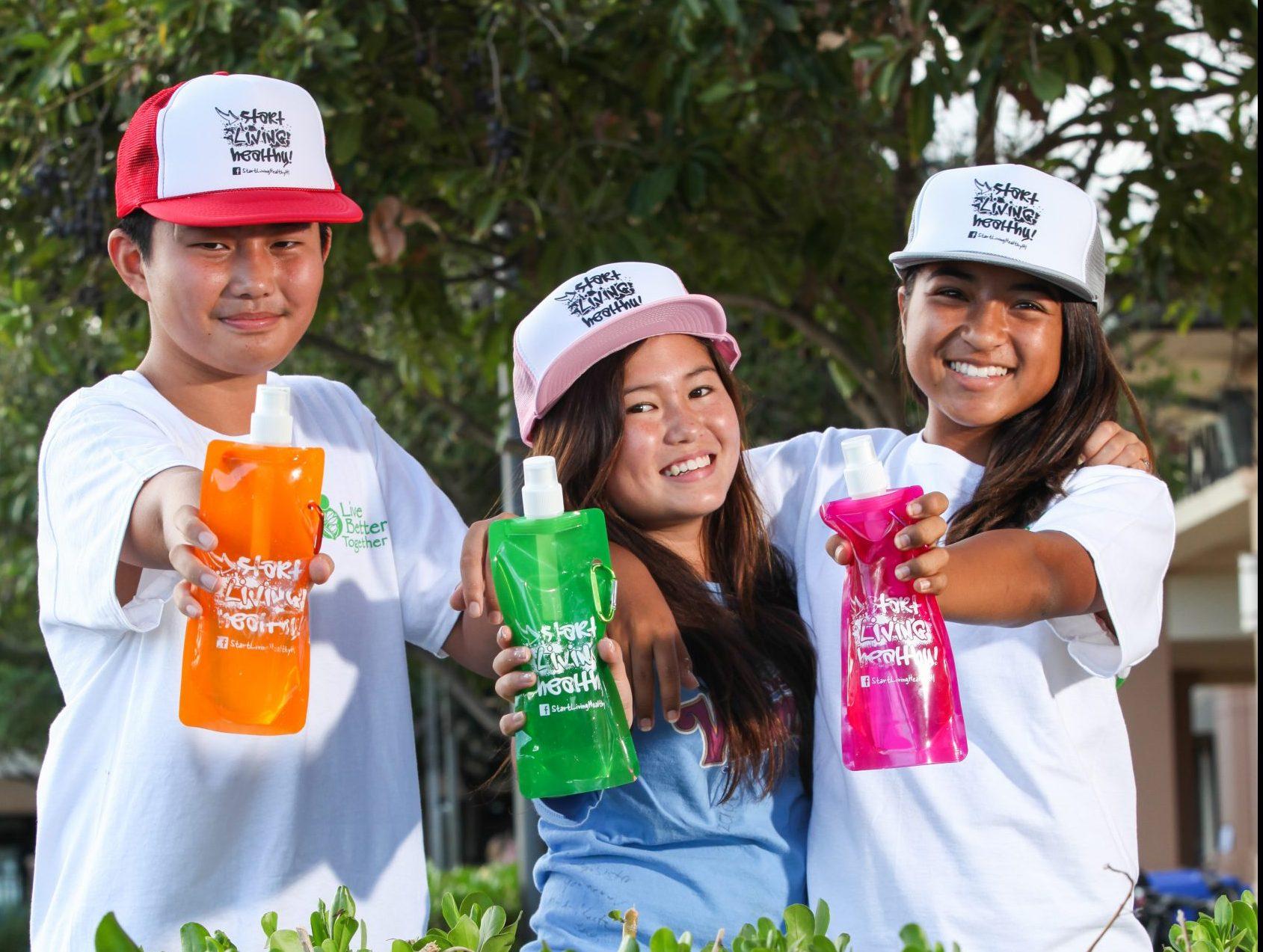 Kids in Hawaii holding water bottles